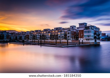 Long exposure at sunset of waterfront condominiums at the Inner Harbor, Baltimore, Maryland. - stock photo