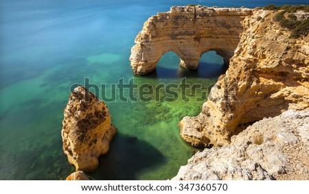 Long exposure at the beach praia da Marinha, Lagoa, Algarve Portugal - stock photo