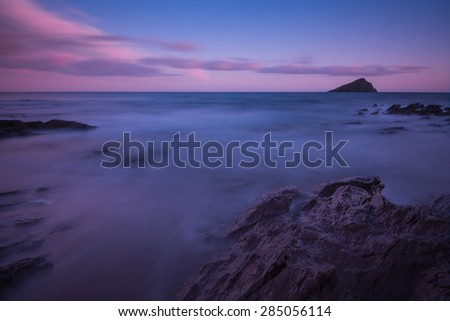 Long exposure blurred waves at beach, seascape at twilight - stock photo