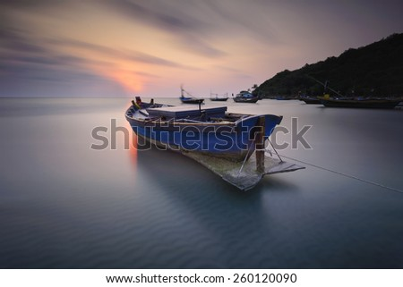 Long Exposure ,Boats at the beach during sunset - stock photo