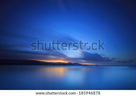 Long exposure dramatic tropical sea and sky sunset - stock photo
