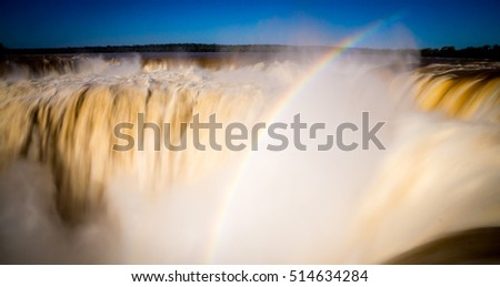 Long-exposure from the top of Iguazu Falls in Argentina with rainbow