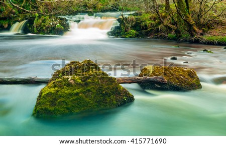 Long exposure image of a beautiful river in Scotland - stock photo