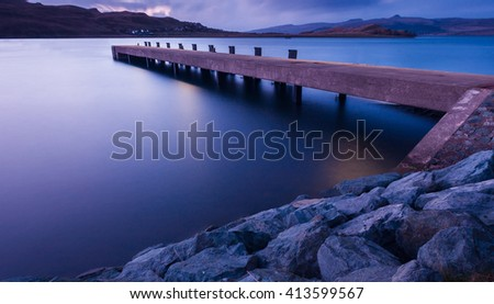 Long exposure image of a scottish pier at sunset