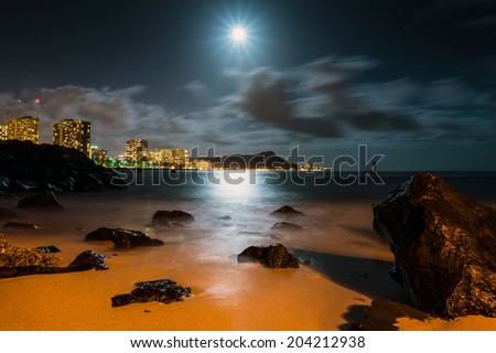 Long exposure image of Diamond Head and Waikiki at night from Ala Moana Beach Park in Honolulu - stock photo