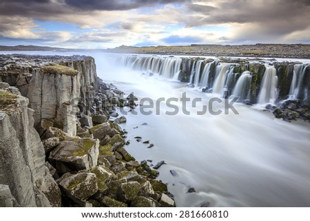 Long exposure image of Selfoss waterfall on Jokulsa a Fjollum river in Iceland - stock photo