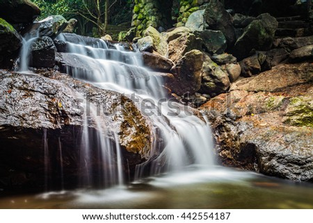 Long exposure image of waterfall in Ecological Tourist Area Thien Son - Suoi Nga, Thien Son - Suoi Nga located in Ba Vi, Vietnam.is a beautiful natural wonder combining mountains, and waterfalls slot
