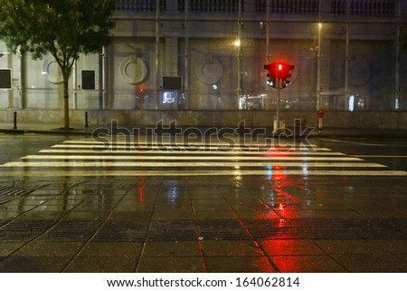 Long exposure in night traffic on road and pedestrian crossing  - stock photo