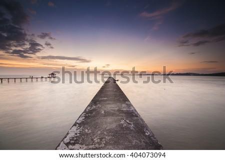 Long exposure in the sunset at jetty of fisherman beach, at Pasir Panjang Port Dickson Negeri Sembilan. Soft Focus due to Long Exposure Shot. Copy Space Area. - stock photo