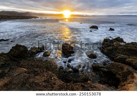 Long exposure Intense Sunset over the Pacific in Big Sur on the California Central Coast - stock photo