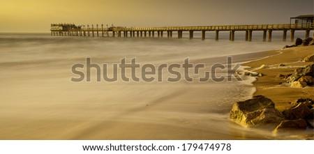 long exposure jetty in beautiful light - stock photo