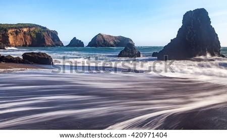 Long exposure landscape seascape of rocky coastline. Rodeo Beach, California. USA - stock photo