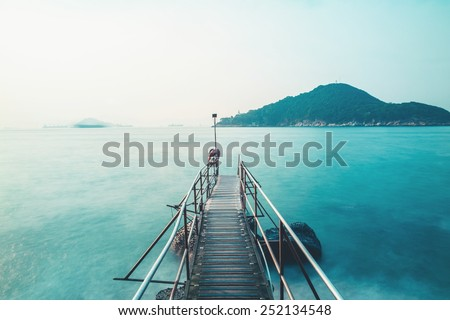 Long exposure of a bridge of pier - stock photo