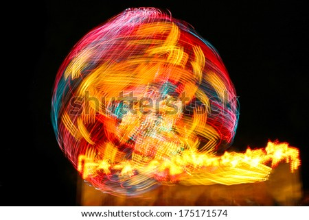 long exposure of a carnival ride lights - stock photo