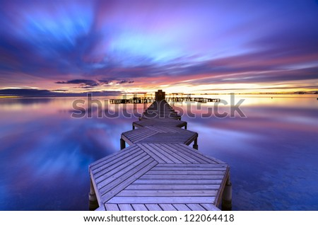 Long Exposure of a colorful sunrise in a zigzag pier placed in Mar Menor, Murcia, Spain - stock photo