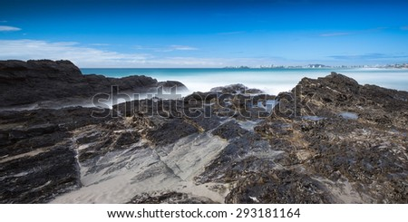 Long Exposure of a Peaceful Landscape with Rocky Coastline and Ghostly Ocean, Gold Coast, Currumbin Beach, Australia