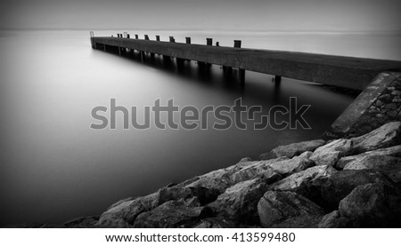 Long exposure of a scottish pier in black and white - stock photo