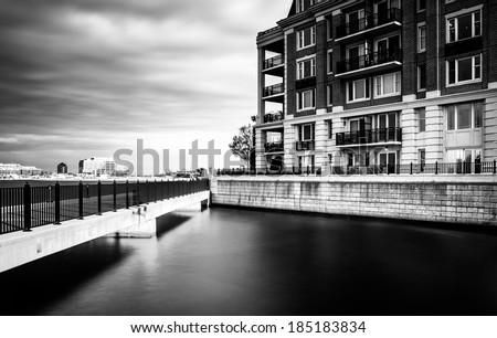 Long exposure of bridge and waterfront condominiums in the Inner Harbor, Baltimore, Maryland. - stock photo