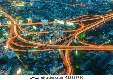 Long exposure of car light on express way cross road, Bangkok skyline in Thailand - stock photo
