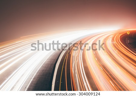 Long exposure of car lights on a freeway - stock photo