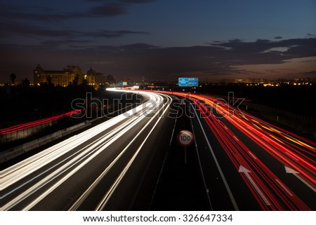 Long exposure of cars passing by Highway in Valencia, Spain . - stock photo