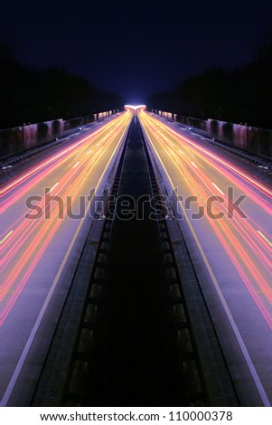 Long-exposure of cars rushing over a highway - stock photo