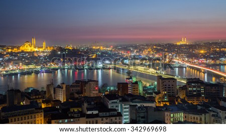 Long exposure of golden horn with mosque skyline in Istanbul at night - stock photo