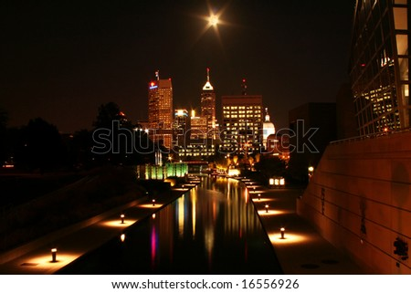 Long exposure of Indianapolis skyline at night under full moon