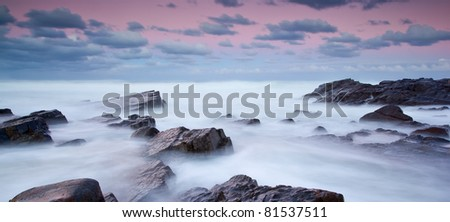 long exposure of misty sea and rocks - stock photo