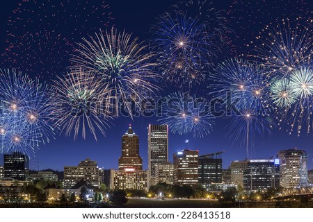 Long Exposure of Portland's downtown buildings and skyscrapers in an early night with fireworks on the sky - stock photo