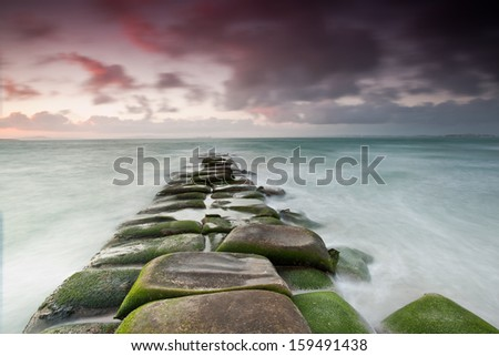 long exposure of rocks and sea   - stock photo