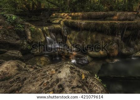 long exposure of rocky waterfall   - stock photo