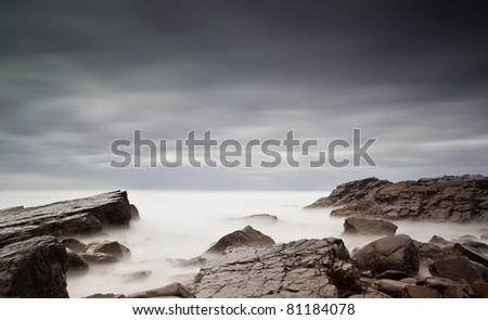 long exposure of sea and rocks - stock photo