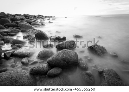 Long exposure of sea and rocks. Black and white.