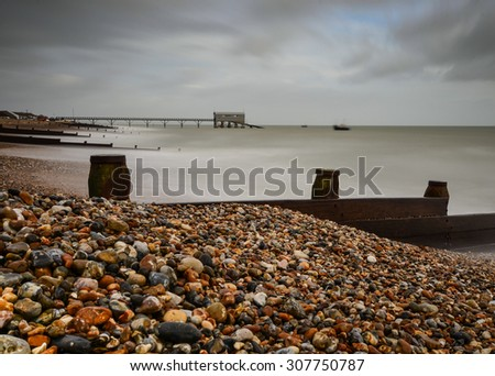 Long exposure of Selsey Lifeboat station and pebble beach with sea defence
