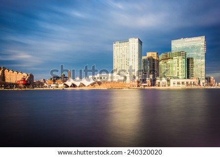 Long exposure of skyscrapers in Harbor East, seen from the Inner Harbor, in Baltimore, Maryland. - stock photo