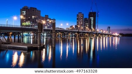 Long Exposure Of The Southport City Skyline With Sundale Bridge And A Wide Open Canal At Twilight, Gold Coast, Queensland, Australia