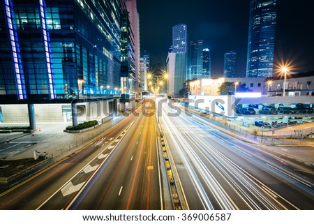 Long exposure of traffic on Connaught Road and skyscrapers at night, in Hong Kong, Hong Kong.