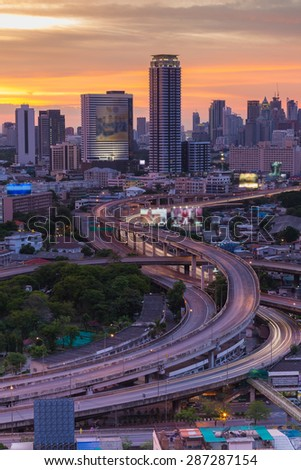 Long exposure of Traffic on Express way during sunset through main business area of Bangkok, Thailand - stock photo
