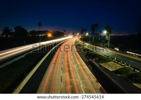 Long exposure of traffic on US 101 at night, in Ventura, California. - stock photo