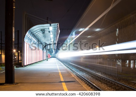 Long exposure of train passing by. - stock photo
