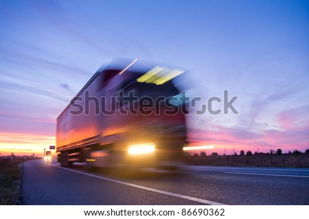 long exposure of truck at sunset - stock photo