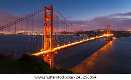 Long exposure panorama of Golden Gate Bridge at dusk. - stock photo