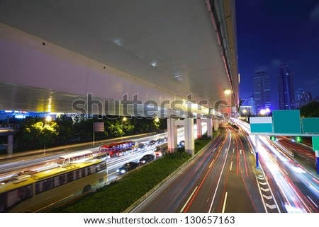 Long exposure photo High-speed urban viaduct construction background at night