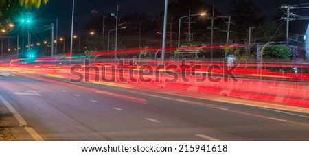 Long exposure photo of light trails on the street in Thailand. - stock photo