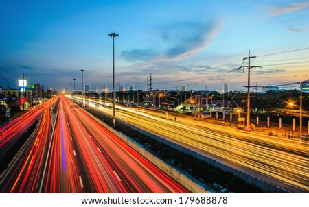 Long exposure photo of traffic on the move at dusk skyline in Bangkok, Thailand - stock photo