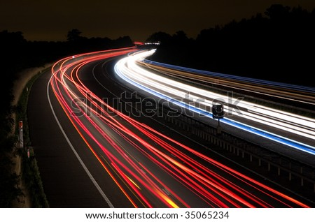 Long exposure photo of traffic on the move at night on the M40 motorway in England