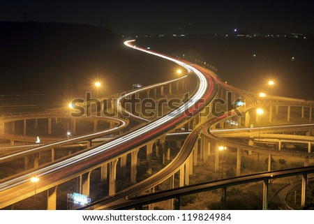 Long exposure photo of traffic on the move,  highway ,Taichung , Taiwan - stock photo