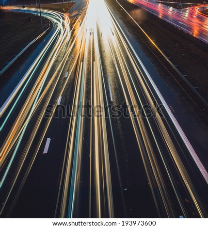 Long exposure photo of traffic, top view, square format - stock photo