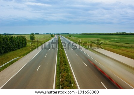 Long exposure photo of vehicle on motorway